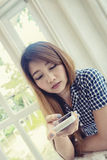 Young asian woman using smart phone in cafe Stock Photo