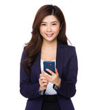 Young Asian woman using a smart phone Royalty Free Stock Images