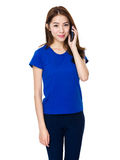 Young Asian woman using a smart phone Royalty Free Stock Photos