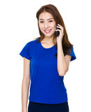 Young Asian woman using a smart phone Stock Image