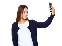 Young Asian woman using a smart phone Stock Photo