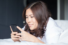 Young asian woman using smartphone Stock Photo
