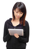 Young asian woman using tablet computer Stock Photo