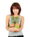Young asian woman with variety of oriental fruits. Royalty Free Stock Images