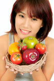 Young asian woman with various fruits. Isolated young asian woman with various fruits Stock Photos