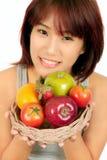 Young asian woman with various fruits Stock Photos