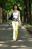 Young Asian woman walking. Stock Photography