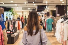 Young asian woman walking in clothes store Royalty Free Stock Photography