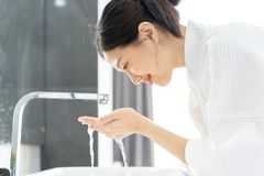 Free Young Asian Woman Washing Her Face In Bathroom. Royalty Free Stock Photo - 167392175