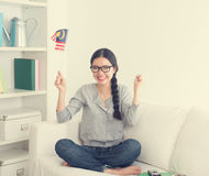 Young asian woman watching movie Royalty Free Stock Photo