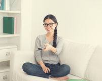 Young asian woman watching movie Stock Images