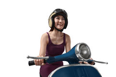 Young asian woman wearing helmet has fun sitting on an old scoot Royalty Free Stock Image