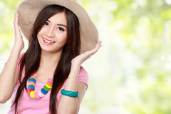 Young asian woman wearing summer hat Royalty Free Stock Photography