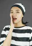 Young Asian woman whispering in prisoners uniform Stock Photos