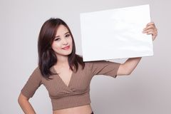 Young Asian woman with white blank sign. royalty free stock photo