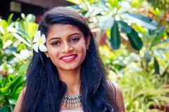 Free Young Asian Woman With Black Hair Plumeria And Fresh Skin, Looking And Smiling At The Camera On Park Summer Background Stock Photo - 159381630