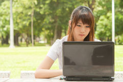 Young Asian woman working Stock Photography