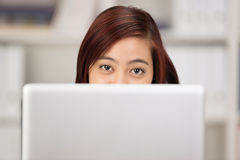 Young Asian woman working at a computer Stock Photos
