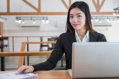Young Asian woman working at a desk in business sector. Good teamwork meeting in office, workplace strategy Stock Photo
