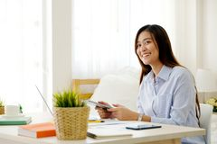 Young asian woman working with digital tablet at home office with happy emotion, working from home, small business, office casual. Lifestyle concept royalty free stock photos