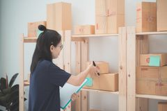 Young Asian Woman Working at home, Young business start up onlin Royalty Free Stock Image