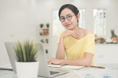 Young Asian Woman Working at home, Young business start up onlin Royalty Free Stock Images