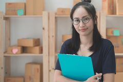Young Asian Woman Working at home, Young business start up onlin Stock Image