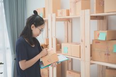 Young Asian Woman Working at home, Young business start up onlin Royalty Free Stock Photo