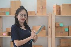 Young Asian Woman Working at home, Young business start up onlin Royalty Free Stock Photos
