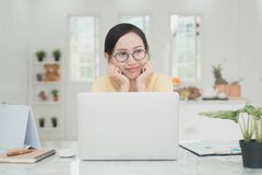 Young Asian Woman Working at home, Young business start up onlin. E seller owner, Delivery Project, Woman with Online Business or SME Concept stock image