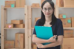 Young Asian Woman Working at home, Young business start up onlin. E seller owner, Delivery Project, Woman with Online Business or SME Concept royalty free stock image