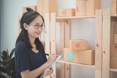 Young Asian Woman Working at home, Young business start up onlin Stock Photos