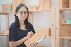 Young Asian Woman Working at home, Young business start up onlin Stock Photography