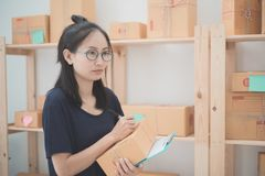 Young Asian Woman Working at home, Young business start up onlin. E seller owner, Delivery Project, Woman with Online Business or SME Concept royalty free stock photography