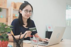 Young Asian Woman Working at home, Young business start up onlin. E seller owner, Delivery Project, Woman with Online Business or SME Concept royalty free stock photos