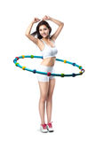 Young asian woman working with hula hoop smiling Royalty Free Stock Images