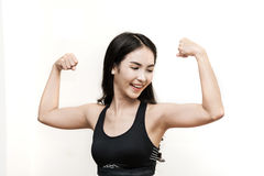 Young Asian woman working out in the gym. Stock Image