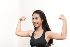 Young Asian woman working out in the gym. Royalty Free Stock Images