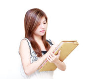 Young Asian Woman writing diary Royalty Free Stock Photo