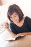 Young asian woman writing diary. Stock Photos