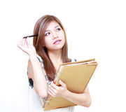 Young Asian Woman writing diary or thinking. On white background Stock Image