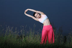 Young asian woman YOGA outside Stock Photos