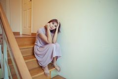 Young asian womanl sits alone on stairs Royalty Free Stock Images