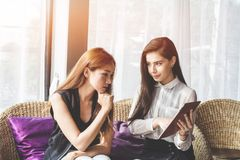 Young Asian. women Business people meeting point to discuss, plan. Trading of economic cosmetics. stock photos
