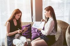 Young Asian. women Business people meeting point to discuss, plan. Trading of economic cosmetics. royalty free stock image