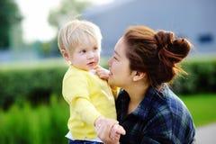 Young asian women with cute caucasian toddler boy Stock Photos
