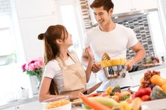 Young asian woman cutting slice vegetables making salad healthy food. Young asian women cutting slice vegetables making salad healthy food with fruits and men Royalty Free Stock Photography