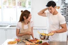 Young asian woman cutting slice vegetables making salad healthy food. Young asian women cutting slice vegetables making salad healthy food with fruits and men Royalty Free Stock Photos