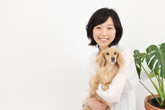 Young Asian women with dachshund Stock Photos