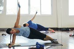 Women doing side plank royalty free stock image